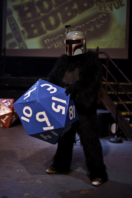 Performer at Hubba Hubba's Broadsword Burlesque. Wearing Boba Fett's helmet, what seems to be a Wookie outfit, and holding a giant 20-sided die