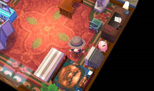 Yep, that's Reggie's face on his bedspread. [via nintendo3dsblog]