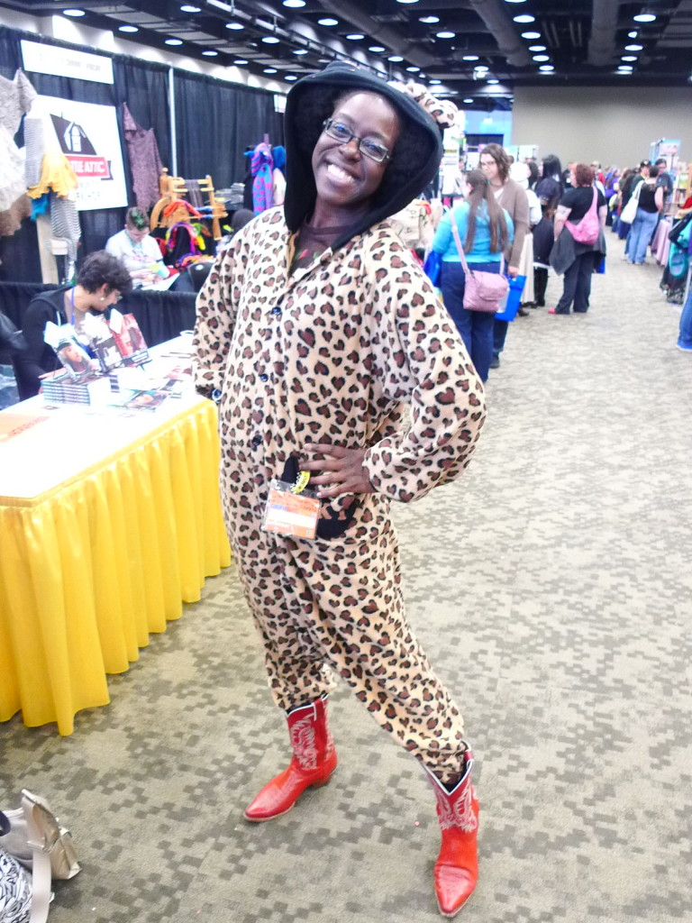 Lola LeSoleil wearing an adorable cheeta print hooded jumpsuit and red cowboy boots